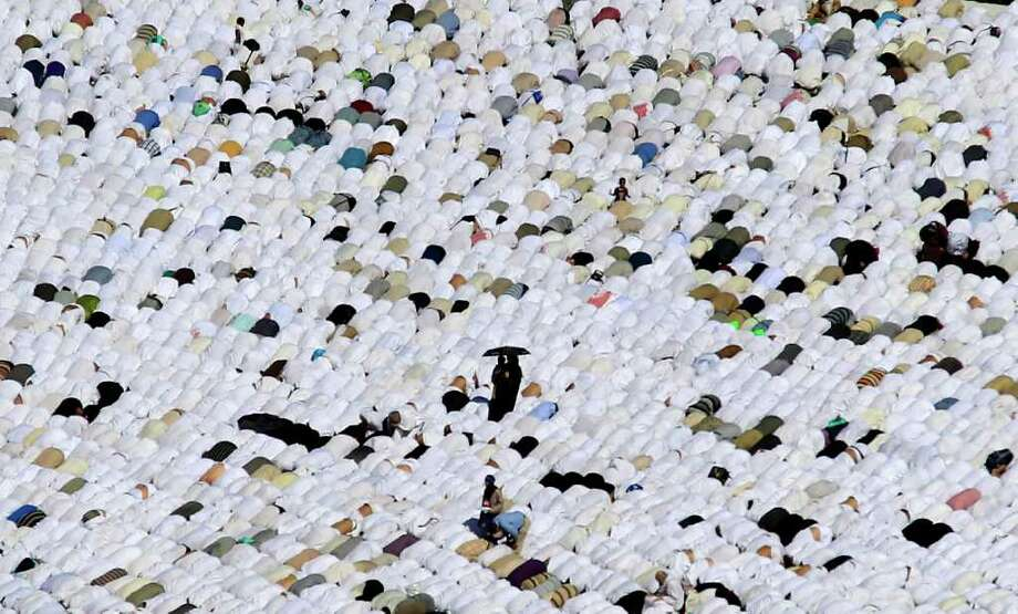 Tens of thousands of Muslim pilgrims pray inside the Grand Mosque, in Mecca, Saudi Arabia. Photo: Hassan Ammar, Associated Press / Copyright 2011 The Associated Press. All rights reserved. This material may not be published, broadcast, rewritten or redistribu
