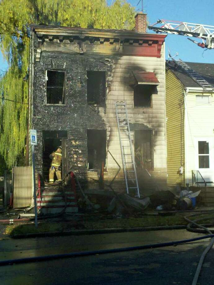 A blaze tore through a single-family home on Livingston Avenue on Friday afternoon, leaving a man and his brother homeless. (Dayelin Roman / Times Union)