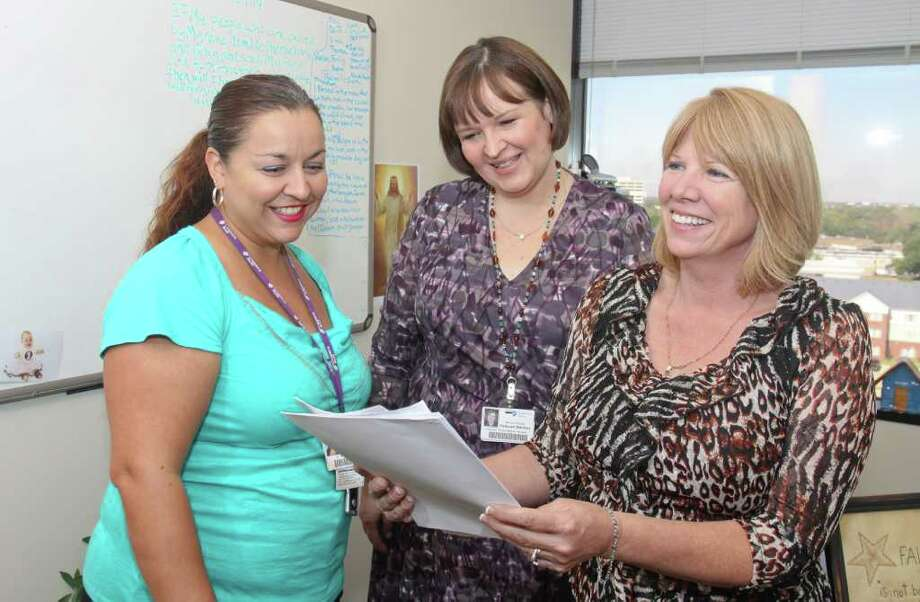 GARY FOUNTAIN : FOR THE CHRONICLE WORKER-FRIENDLY POLICIES: Christus Health earned high marks from its 600 local employees. From left, Raquel Villareal, Deborah Simmen and Marsha Toole Gosney are part of its workforce. Photo: Gary Fountain / Copyright 2011 Gary Fountain