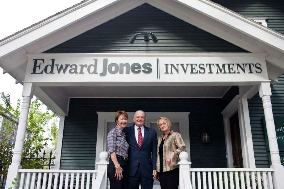 ERIC KAYNE : FOR THE CHRONICLE EMPLOYEE-OWNED COMPANY: Branch manager Buddy Bailey picked for his office a historic home. With him is wife Cindy Bailey, left, and employee Sharon Pannel. Photo: Eric Kayne / © 2011 Eric Kayne