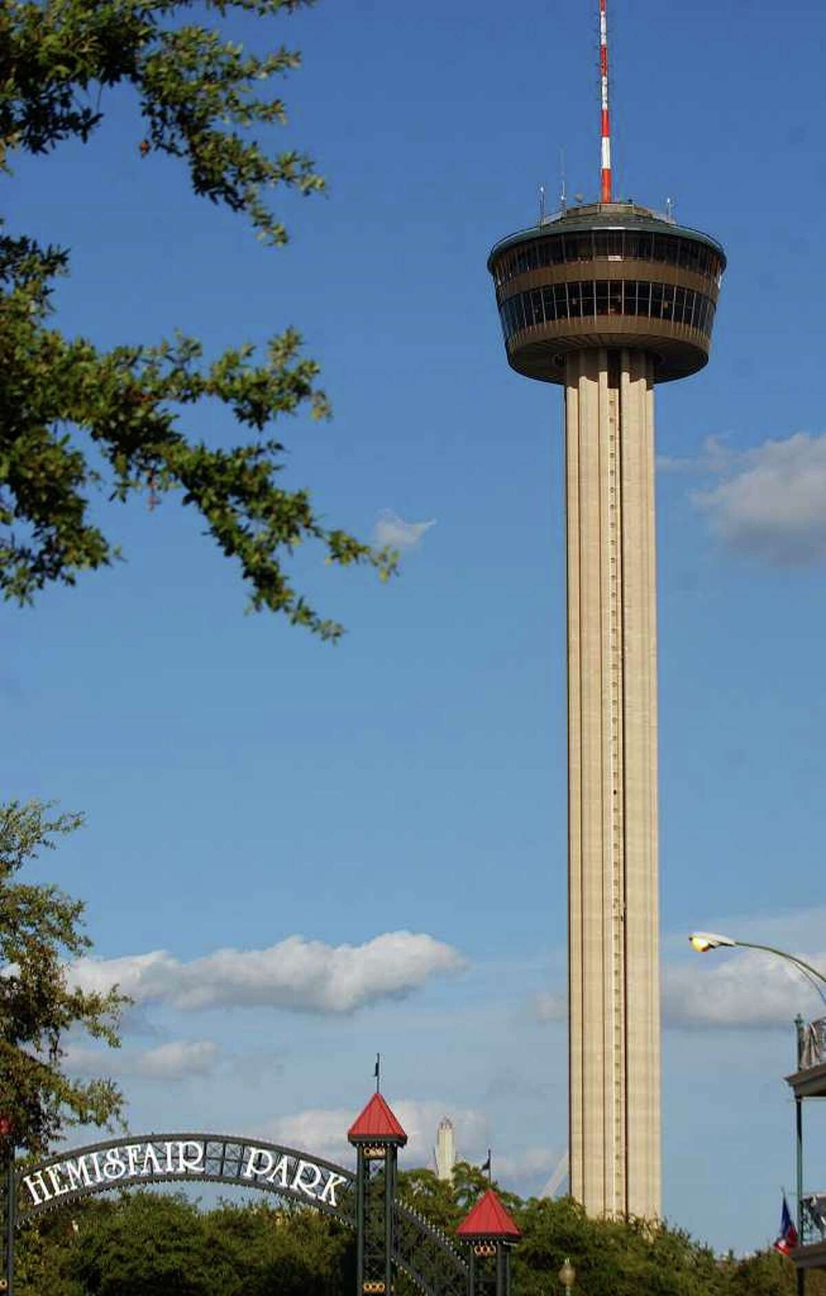 A view of the Tower of the Americas and the Hemisfair Park sign Friday June 16, 2006.