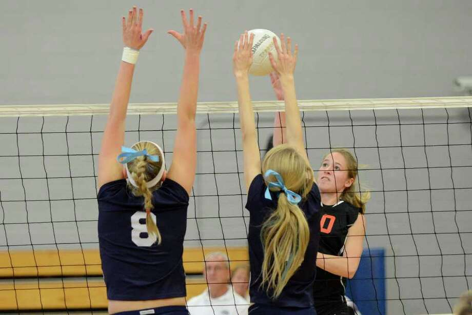 Ridgefield's Megan Kirchoff works the net against Staples #8 Josephine Grevers and Amelia Brackett as Staples High School challenges Ridgefield High School in volleyball at Fairfield Ludlowe High School in Fairfield, CT on Fri., Nov. 4, 2011. Photo: Shelley Cryan / Shelley Cryan freelance; Connecticut Post freelance