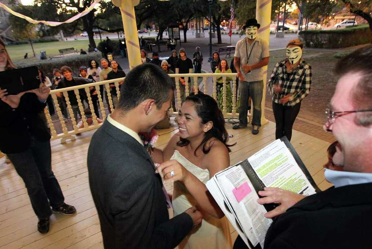 The Occupy SA movement held a wedding of two participants at HemisFair Plaza on Friday, Nov. 4, 2011. The couple Victoria Saucedo (center right) and Kristian Rodriguez tied the knot on Friday as several other Occupy SA protestors watched the ceremony take place. The Occupy protest in San Antonio is entering near the one-month mark and despite reports of arrests of protesters, this group has remained reasonably peaceful. Kin Man Hui/kmhui@express-news.net