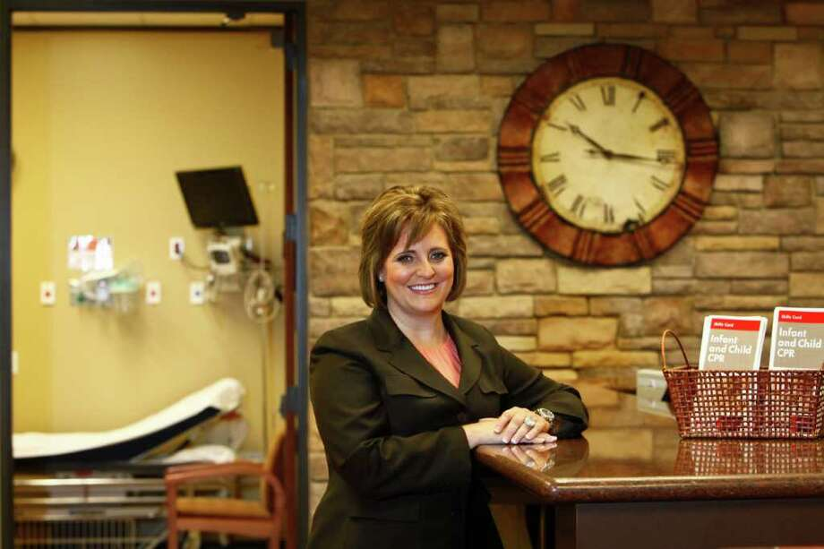 """MICHAEL PAULSEN : CHRONICLE 'WE MAKE IT FUN': Rhonda Sandel, CEO of Texas Emergency Care Center, says, """"We have created a very incentive-based workplace."""" Photo: Michael Paulsen / © 2011 Houston Chronicle"""