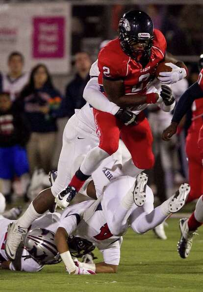 James White of Dawson High School (2) tries to jump over Jared Ambres of Manvel Hih School during th