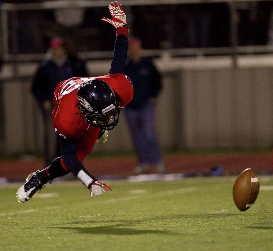 Jarell Crenshaw of Dawson High School fumbles a punt during the second quarter of a 24 4A high school football game against Manvel High School, Friday, Nov. 4, 2011, at The Rig in Pearland. Photo: Nick De La Torre, Houston Chronicle / © 2011  Houston Chronicle