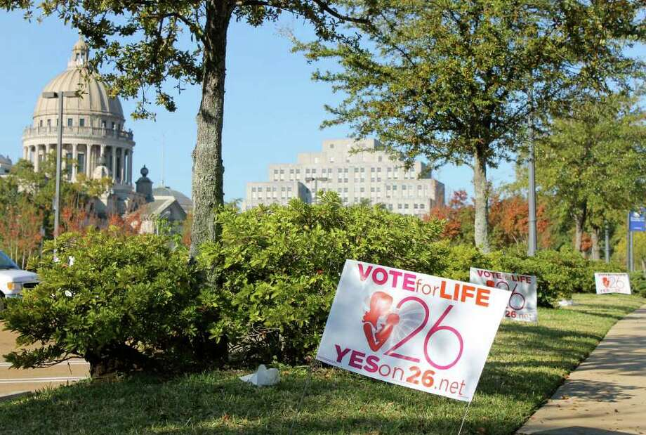 ESME E. DEPREZ : BLOOMBERG NEWS  HEADED TO A VOTE: Signs in favor of initiative 26 is displayed near the Capitol in Jackson, Miss. Voters on Nov. 8 will decide whether Mississippi will be the first state in the U.S. to ban abortion by defining that life begins at conception. Photo: Esme E. Deprez / © 2011 Bloomberg Finance LP