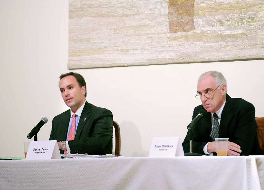 Republican First Selectman Peter Tesei, left, and Democratic first selectman candidate John Blankley during the Board of Selectmen and tax collector candidates debate hosted by the the Round Hill Association, Northwest Greenwich Association and Northeast Greenwich Association at the Round Hill Community Church Oct. 19, 2011. Photo: Bob Luckey, Greenwich Time File / Greenwich Time