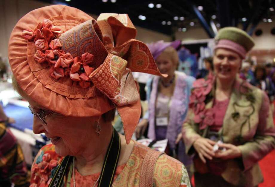 Mayra BeltrÁn : Houston Chronicle  STYLE COUNTS: Laroyce Coy, of Friendswood, sports a handmade hat and outfit at the International Quilt Festival. Photo: Mayra Beltran / © 2011 Houston Chronicle