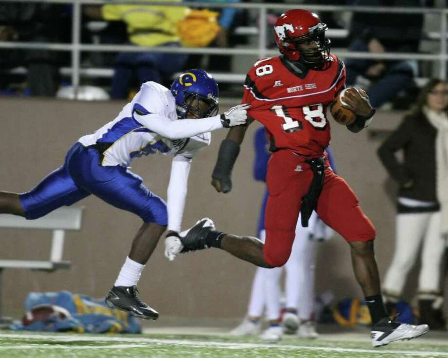 North Shore's Micah Thomas (right) makes a 57-yard gain as Channelview's Kevshaud Busby tries to make the tackle during the first half of a District 21-5A high school football game, Friday, November 4, 2011 at Galena Park Stadium in Houston. Photo: Eric Christian Smith, For The Chronicle