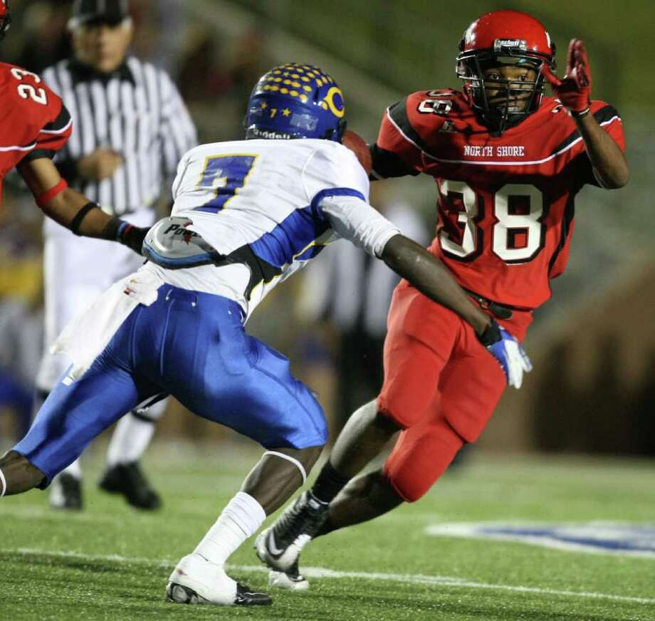 North Shore's Corey Collins (38) runs past Channelview's Marquise Johnson after intercepting Averion Hurts during the first half of a District 21-5A high school football game, Friday, November 4, 2011 at Galena Park Stadium in Houston. Photo: Eric Christian Smith, For The Chronicle