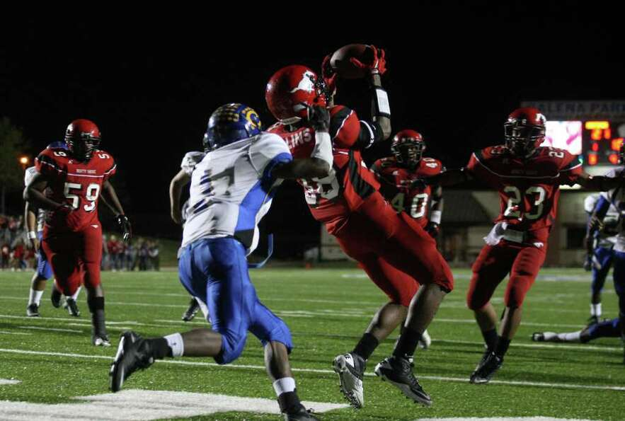 North Shore's Corey Collins (38) intercepts a pass in the end zone intended for Channelview's Stanle