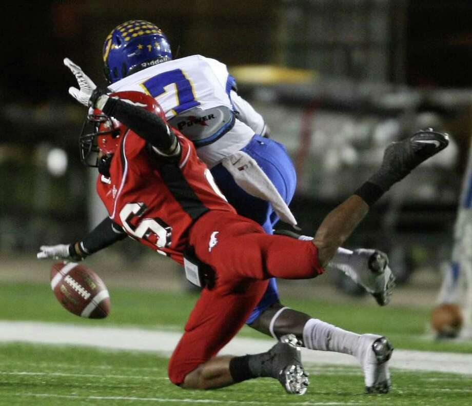 North Shore's Keon Harvison (left) breaks up a pass intended for Channelview's Marquise Johnson during the first half of a District 21-5A high school football game, Friday, November 4, 2011 at Galena Park Stadium in Houston. Photo: Eric Christian Smith, For The Chronicle