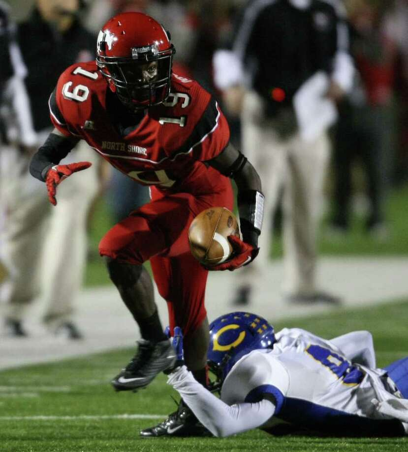 North Shore's Larry McDuffey (19) escapes the tackle of Channelview's Robbie Miller during the first half of a District 21-5A high school football game, Friday, November 4, 2011 at Galena Park Stadium in Houston. Photo: Eric Christian Smith, For The Chronicle