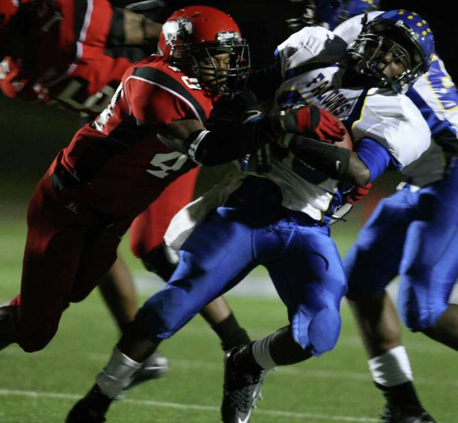 Channelview's Terrell Williams (right) is tackled by North Shore's Ronzel Jones during the first half of a District 21-5A high school football game, Friday, November 4, 2011 at Galena Park Stadium in Houston. Photo: Eric Christian Smith, For The Chronicle