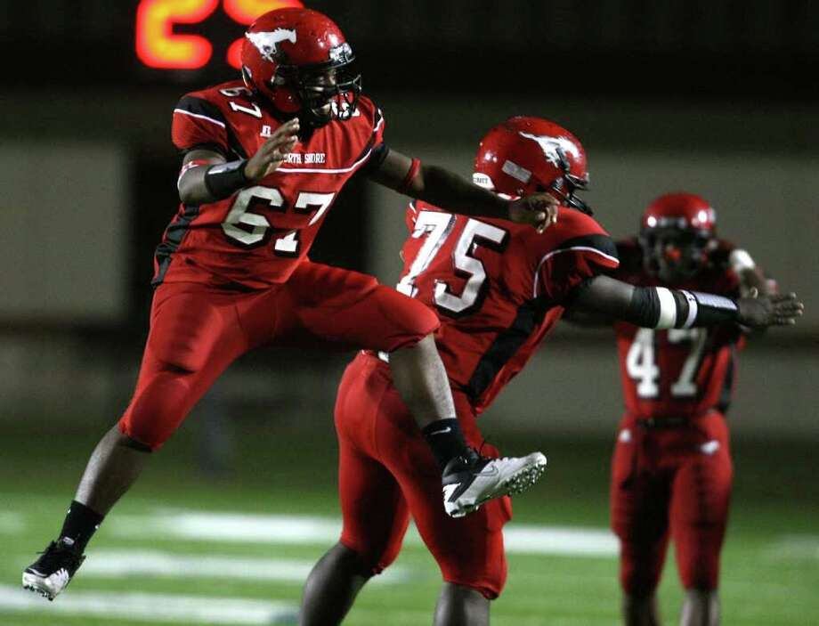 North Shore's Chris Jackson (67) and Jonathan Green get fired up before a District 21-5A high school football game against Channelview, Friday, November 4, 2011 at Galena Park Stadium in Houston. Photo: Eric Christian Smith, For The Chronicle