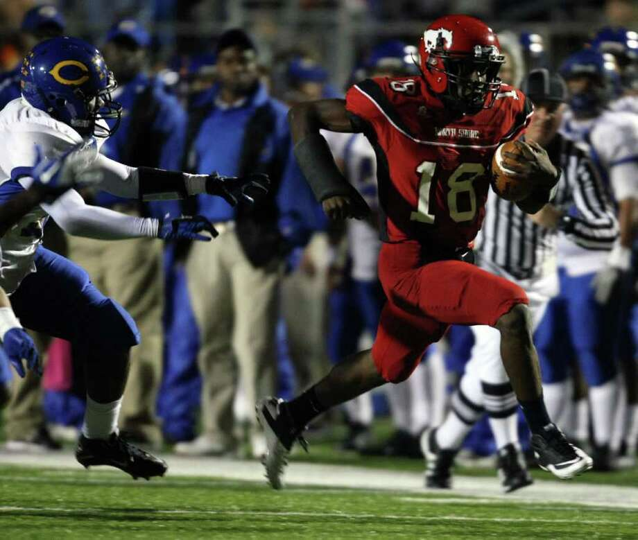 North Shore's Micah Thomas sprints past Channelview's Dwain Taylor during the first half of a District 21-5A high school football game, Friday, November 4, 2011 at Galena Park Stadium in Houston. Photo: Eric Christian Smith, For The Chronicle