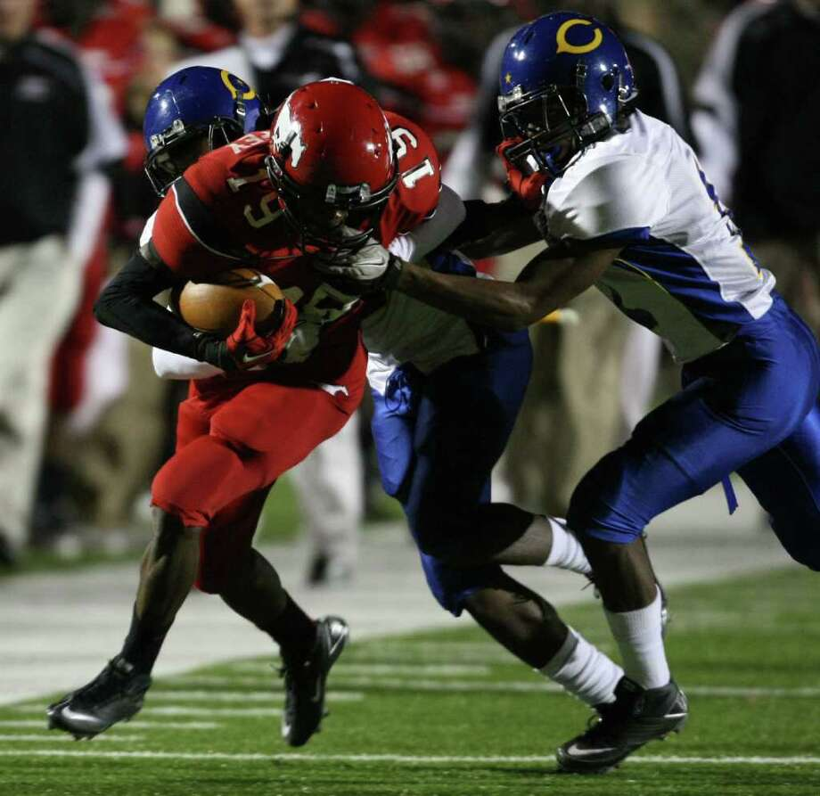 North Shore'sLarry McDuffey (19) is tackled by Channelview's Kelvin Young (right) and Robbie Miller during the first half of a District 21-5A high school football game, Friday, November 4, 2011 at Galena Park Stadium in Houston. Photo: Eric Christian Smith, For The Chronicle