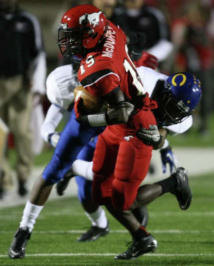 North Shore's Larry McDuffey (19) is tackled by Channelview's Kelvin Young during the first half of a District 21-5A high school football game, Friday, November 4, 2011 at Galena Park Stadium in Houston. Photo: Eric Christian Smith, For The Chronicle