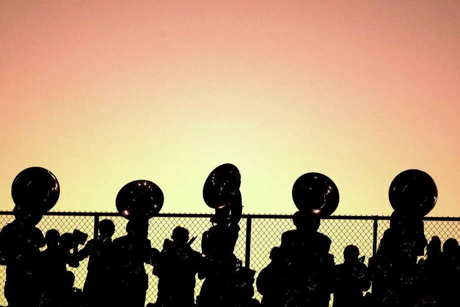 11/4/11: The Friendswood Mustangs band plays the school song as the sun sets before the Mustangs played the Texas City Stingarees in Stingarees Stadium in Texas City, Texas. For the Chronicle :Thomas B. Shea Photo: For To Chronicle :Thomas B. Shea