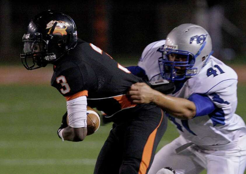 11/4/11:  Running bacK Armanti Foreman #3 of the Texas City Stingaree is tackled by lineman Xavier K