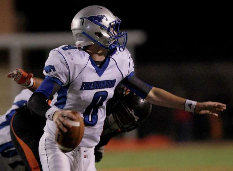 11/4/11: Quarterback Jordan Wood #8 of the Friendswood Mustangs scrambles against the Texas City Sti