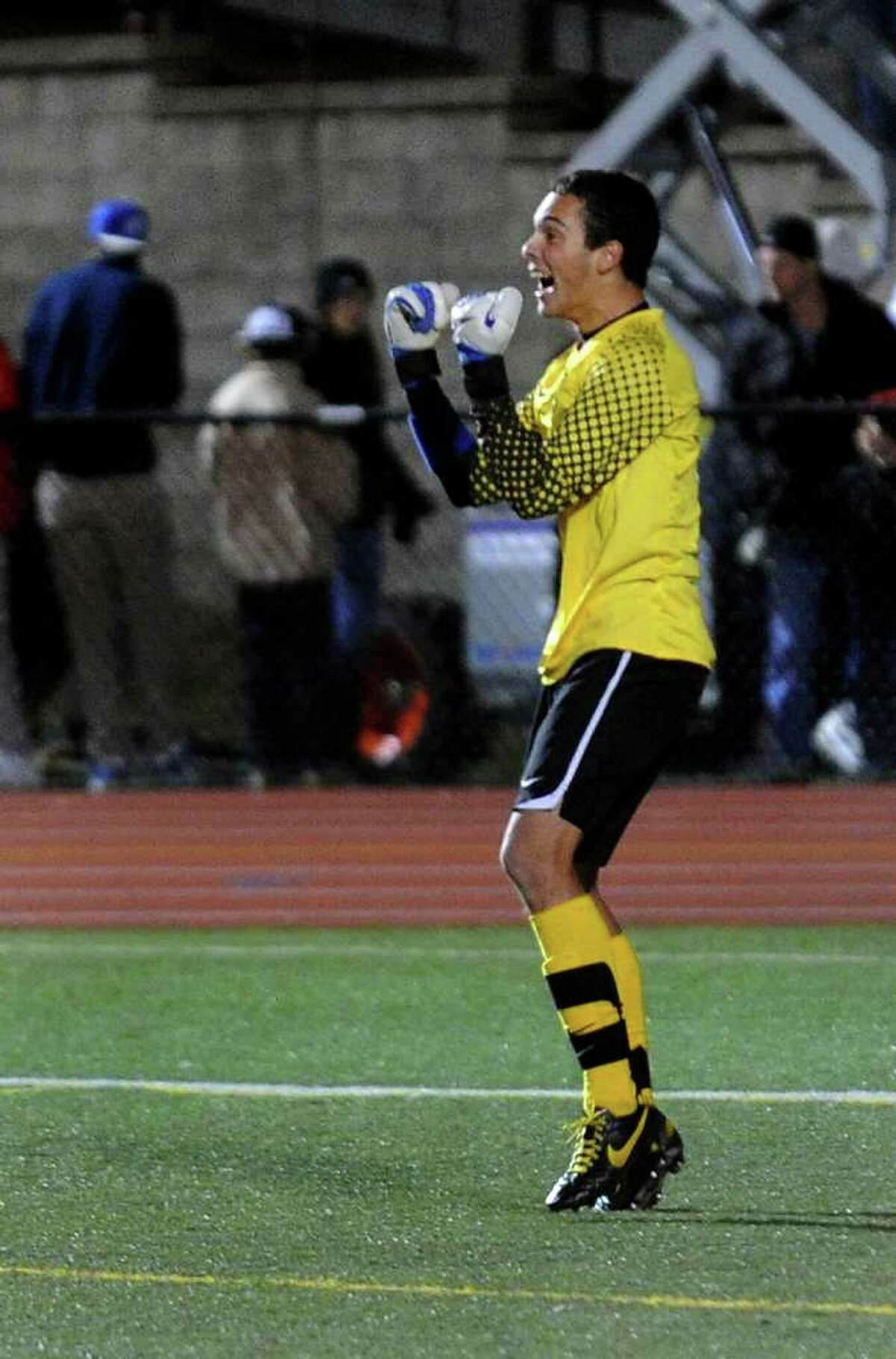 In the final seconds, Trumbull goalie Nick Weinstein gets ready to celebrate the team's win, during FCIAC Boys' Soccer Championship action in Fairfield, Conn. on Friday November 4, 2011.