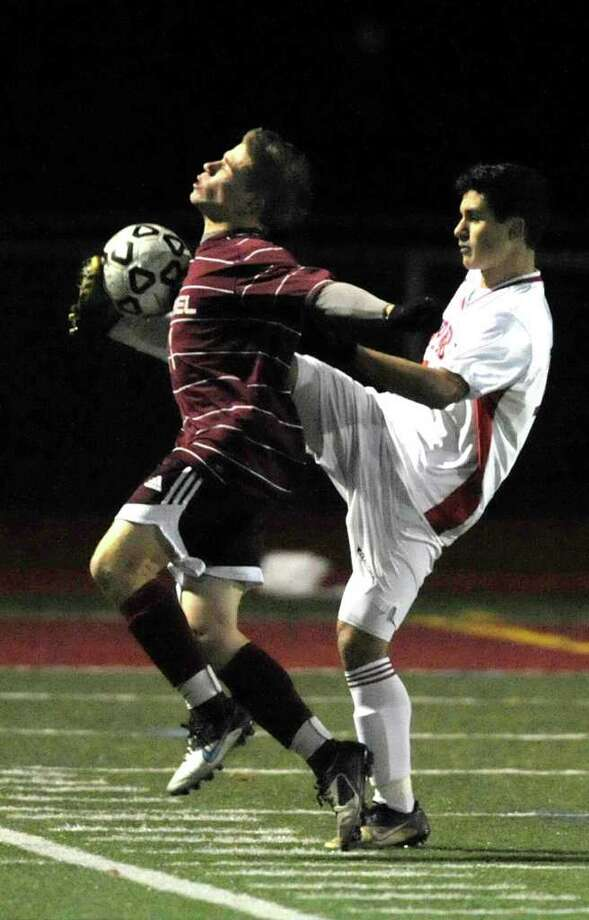 Pomperaug's Kostika Kosova, right, gets a foot on the ball from behind Bethel's Renato Taiule during their SWC semifinal game at Pomperaug High School on Friday, Nov. 4, 2011. Photo: Jason Rearick / The News-Times
