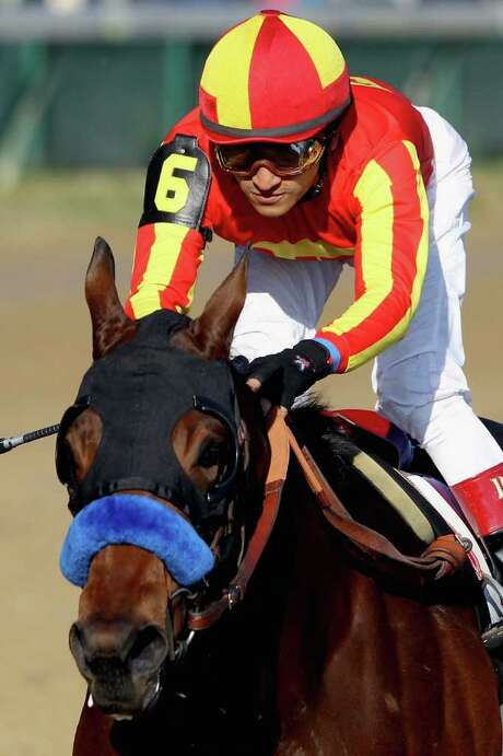 MATTHEW STOCKMAN : GETTY WINNER'S CIRCLE:  Secret Circle, ridden by Rafael Bejarano, won Friday's Juvenile Sprint. Photo: Matthew Stockman / 2011 Getty Images