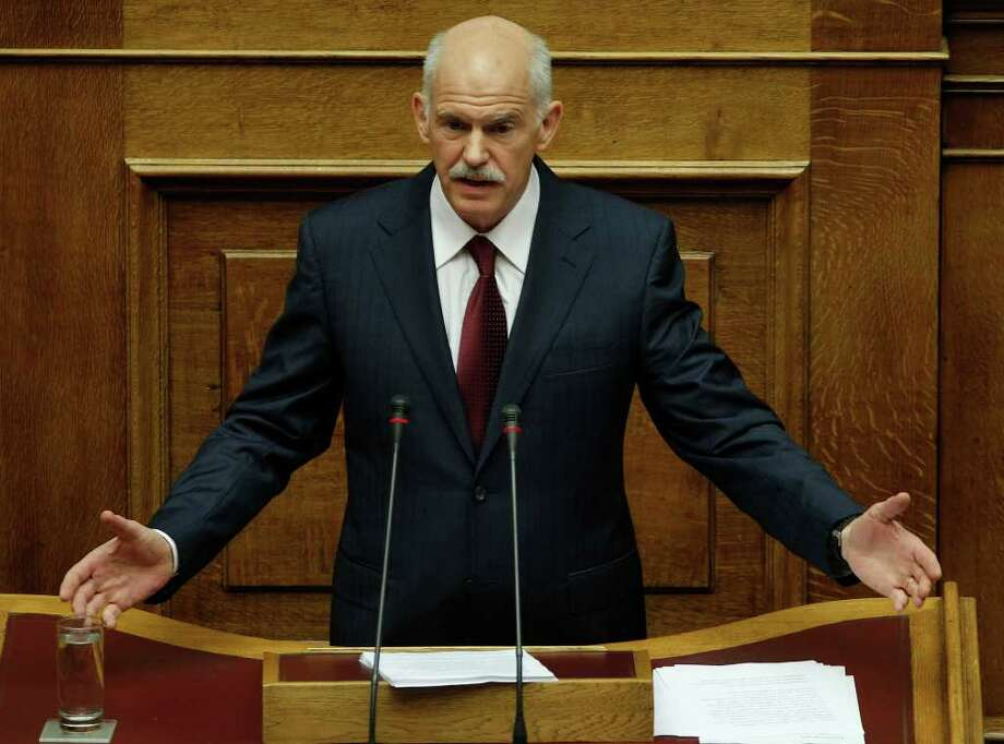 Greek Prime Minister George Papandreou speaks during a confidence vote meeting at the parliament in Athens, on Friday, Nov. 4, 2011. Greece's prime minister says leadership of caretaker government open to negotiation.  (AP Photo/Petros Giannakouris) Photo: Petros Giannakouris / AP
