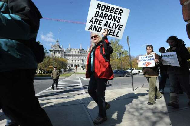 Occupy Albany members march down State St. to Bank of America in Albany, N.Y. Friday, Nov. 4, 2011. The marchers were urging people to close their bank accounts at Bank of America and open an account with a credit union such as SEFCU. (Lori Van Buren / Times Union) Photo: Lori Van Buren