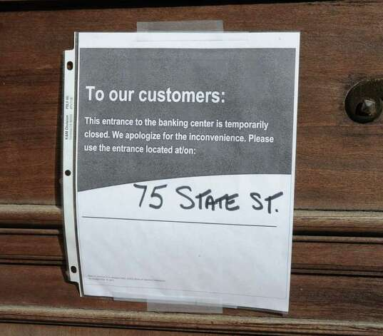 A sign is taped to a door on the Bank of America on State St. in Albany, N.Y. Friday, Nov. 4, 2011. Occupy Albany protesters were urging people to close their bank accounts at Bank of America and open an account with a credit union such as SEFCU. (Lori Van Buren / Times Union) Photo: Lori Van Buren