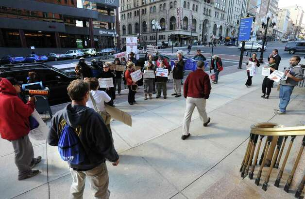 Occupy Albany protesters rally in front of Bank of America on State St. in Albany, N.Y. Friday, Nov. 4, 2011. The protesters were urging people to close their bank accounts at Bank of America and open an account with a credit union such as SEFCU. (Lori Van Buren / Times Union) Photo: Lori Van Buren
