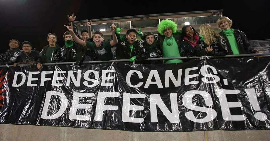 Students from Hioghtower cheer their team on during the 23-5A district championship between Bush and Hightower Friday, November 4, 2011 in Missouri City, Texas. Photo: Bob Levey, Houston Chronicle / ©2011 Bob Levey