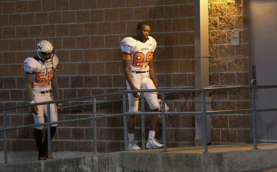 A dejected Michael Fintan #88 and Henry Offiah #50 walk to the locker room after losing to Hightower in overtime during the 23-5A district championship between Bush and Hightower Friday, November 4, 2011 in Missouri City, Texas. Photo: Bob Levey, Houston Chronicle / ©2011 Bob Levey