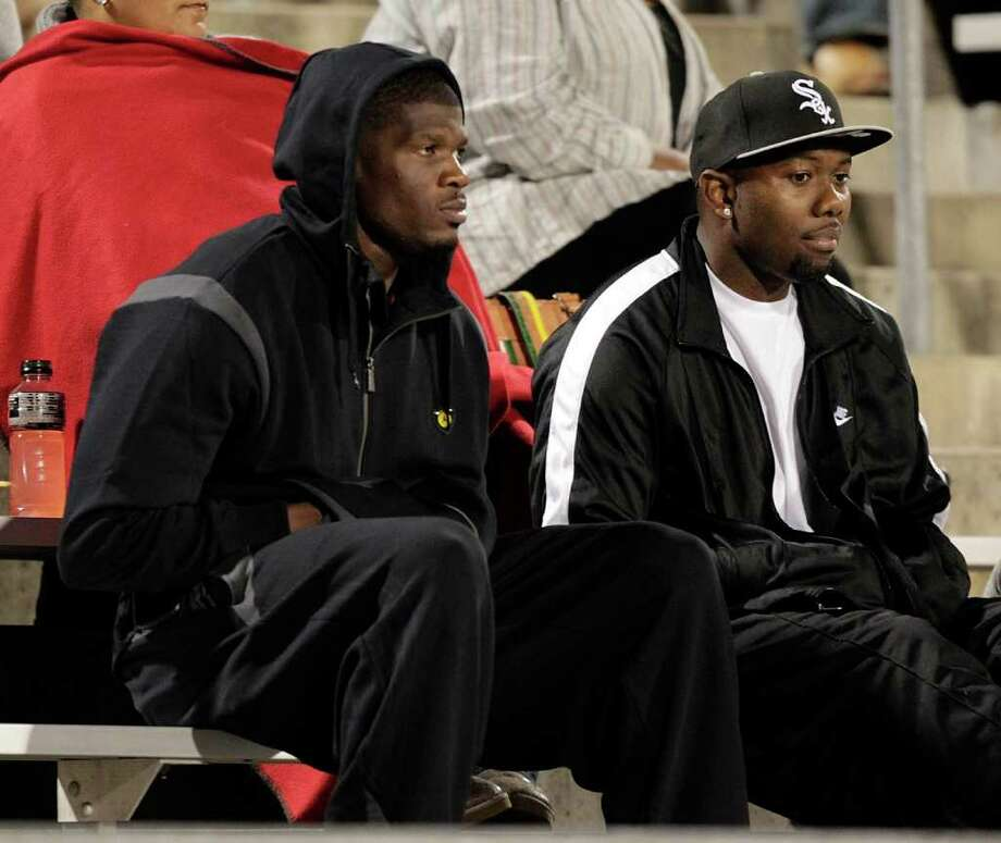 Houston Texans wide receiver Andre Johnson, left. was in the crows during the 23-5A district championship between Bush and Hightower Friday, November 4, 2011 in Missouri City, Texas. Photo: Bob Levey, Houston Chronicle / ©2011 Bob Levey