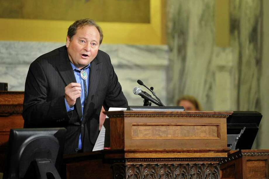 FILE - In this Jan. 26, 2011 file photo, Montana Gov. Brian Schweitzer delivers his 2011 State of the State Address in Helena, Mont. Defying federal authority over gray wolves, Gov. Schweitzer on Wednesday, Feb. 16, 2011encouraged ranchers to kill wolves that prey on their livestock _ even in areas where that is not currently allowed _ and said the state will start shooting packs that hurt elk herds.  Schweitzer told The Associated Press he no longer would wait for federal officials to resolve the tangle of lawsuits over wolves, which has kept the animals on the endangered species list for a decade since recovery goals were first met.  (AP Photo/The Independent Record, Dylan Brown) Photo: Dylan Brown / Helena Independent-Record