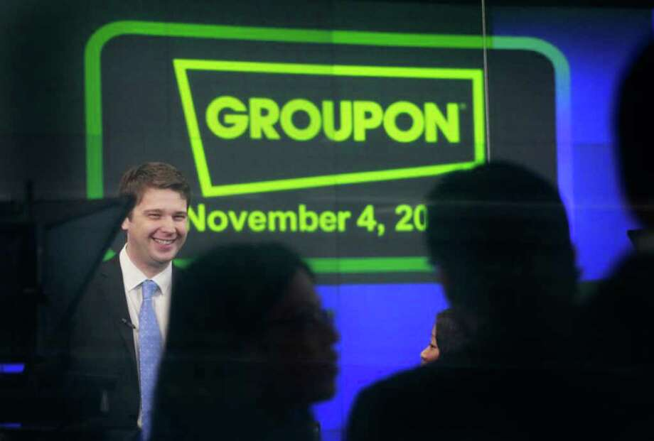 Andrew Mason, founder and CEO of Groupon, attends his company's IPO at Nasdaq, Friday, Nov. 4, 2011, in New York. Groupon, the company that pioneered online group discounts, has begun trading as a public company. The stock jumped nearly 50 percent in the opening minutes Friday. (AP Photo/Mark Lennihan) Photo: Mark Lennihan / AP