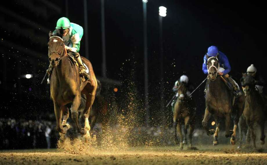 Royal Delta with jockey Jose Lezcano wins the Breeders' Cup Ladies Classic at Churchill Downs in Louisville, K.Y. November 4, 2011.      (Skip Dickstein / Times Union) Photo: SKIP DICKSTEIN