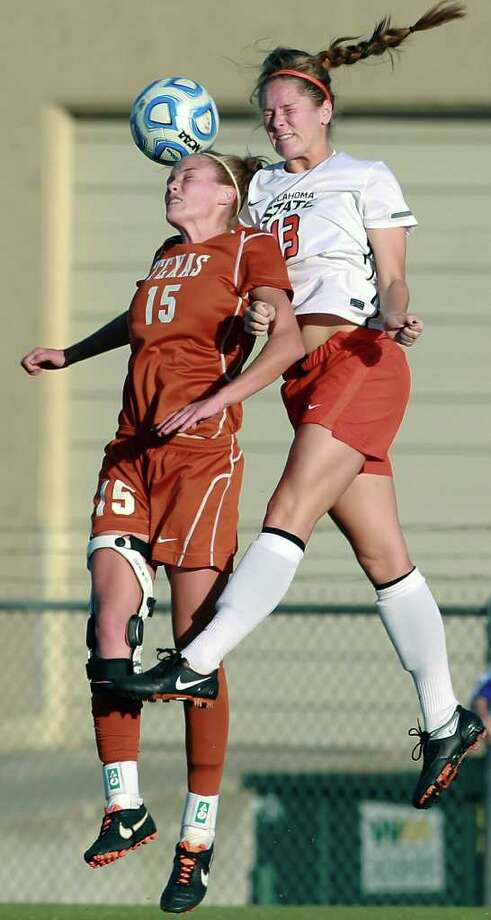 UT's Kylie Doniak (15) battles Carson Michalowski  as Texas plays Oklahoma State in the second round of the 2011 Big 12 Soccer Championship at Blossom Soccer Stadium on November 4, 2011. Photo: TOM REEL, Express-News / © 2011 San Antonio Express-News