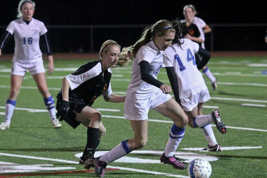 Samantha Taillon, of Bethlehem High School, left, challenges Cassidy Driscoll, of Saratoga Springs High School, center, during a Class AA semifinal game against Shaker High School on Friday, November 4, 2011. (Erin Colligan / Special To The Times Union)