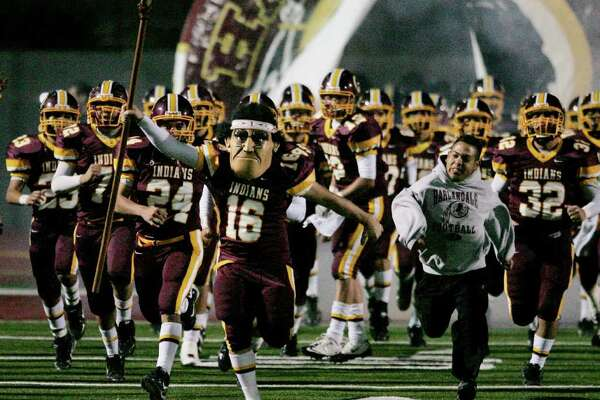 Harlandale takes the field before a high school football game against McCollum, Friday, Nov. 4, 2011, in San Antonio.