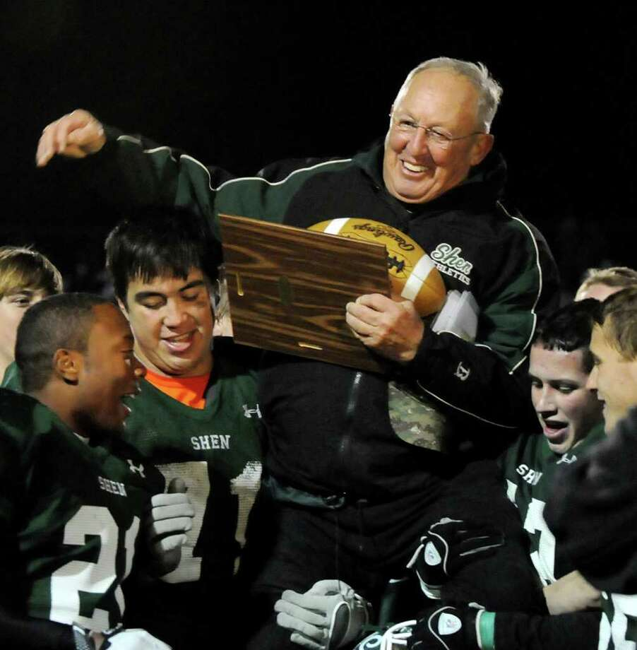 Shen coach Brent Steuerwald rides high on the shoulders of his team after winning the Class AA Super Bowl football game against Columbia on Friday, Nov. 4, 2011, at Shenendehowa High in Clifton Park, N.Y. (Cindy Schultz / Times Union) Photo: Cindy Schultz / 00015201A