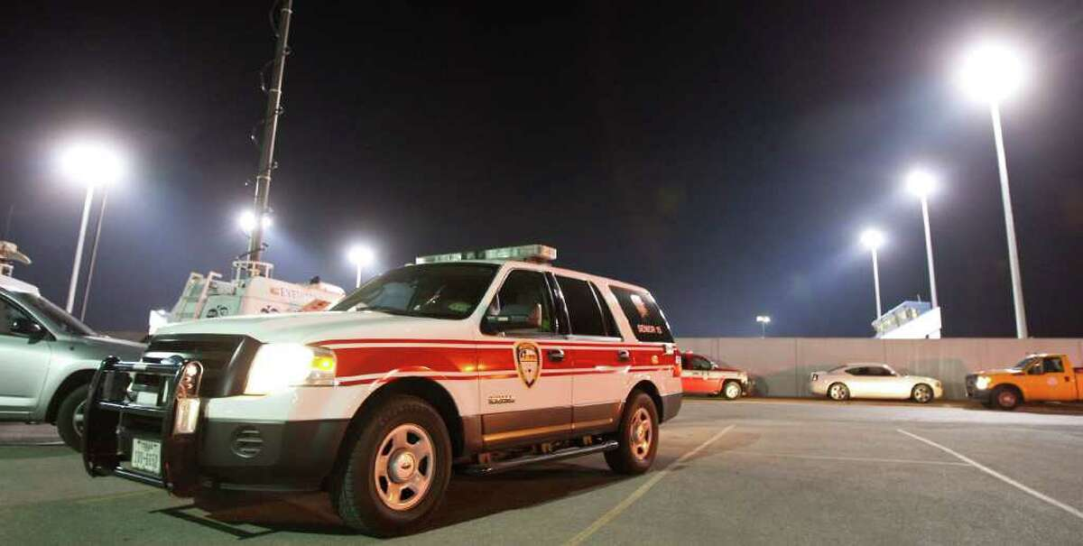 Crews work the scene at Barnett Stadium in Houston on Friday. Austin High band members and others fell ill at a football game.