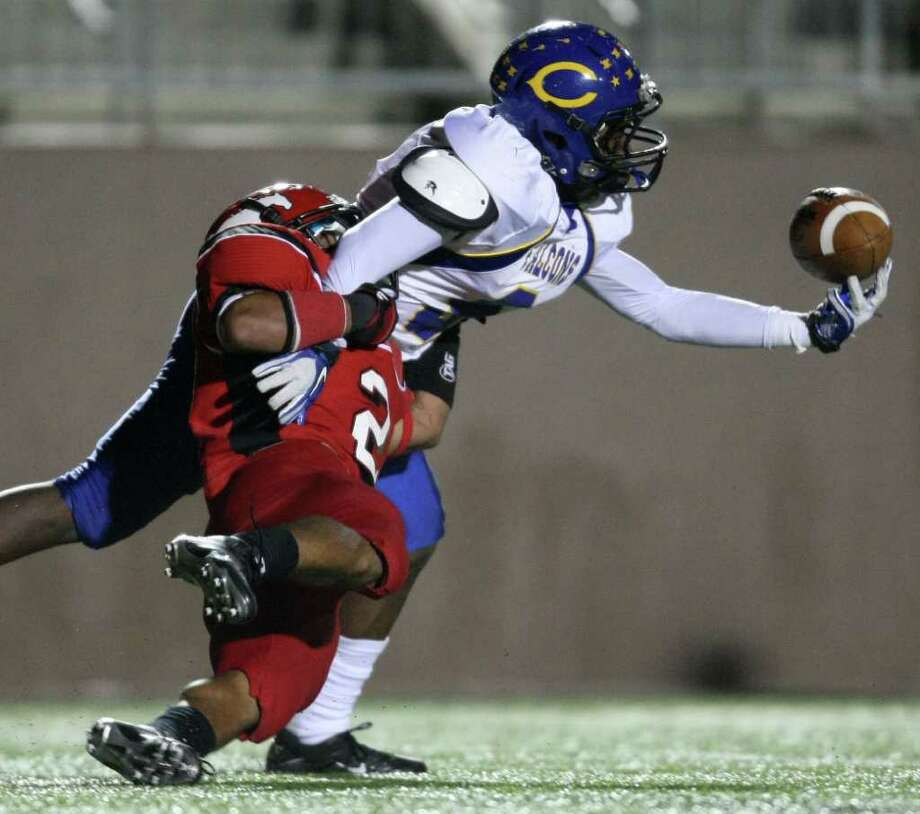 Channelview's Kevshaud Busby (right) almost makes a one-handed interception past North Shore's Kevian DeLeon during the second half of a District 21-5A high school football game, Friday, November 4, 2011 at Galena Park Stadium in Houston. Photo: Eric Christian Smith