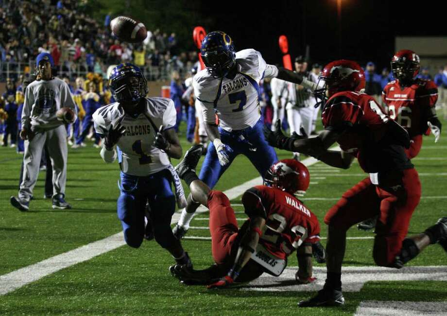 Channelview's Stanley Wesley (1) hauls in a deflected pass by North Shore's Jacoby Walker (23) for a touchdown during the second half of a District 21-5A high school football game, Friday, November 4, 2011 at Galena Park Stadium in Houston. Photo: Eric Christian Smith
