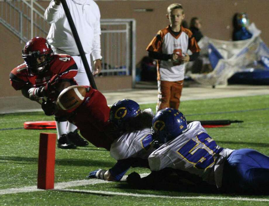 North Shore's Davonte Milton (41) fumbles the ball trying to stretch into the end zone as Channelview's Toddrick Cain (56) Anthony Bush defend during the second half of a District 21-5A high school football game, Friday, November 4, 2011 at Galena Park Stadium in Houston. Photo: Eric Christian Smith