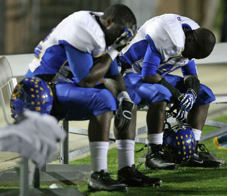 Channelview's Terrell Williams (right) and Leterio Brown sit dejectedly on the bench after North Shore recovered a Falcons fumble in the end zone for a touchdown during the second half of a District 21-5A high school football game, Friday, November 4, 2011 at Galena Park Stadium in Houston. Photo: Eric Christian Smith