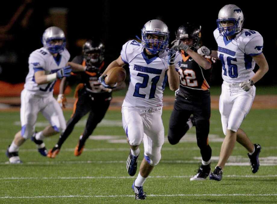 THOMAS B. SHEA: FOR THE CHRONICLE SEEING DAYLIGHT: Friendswood running back Zakk Rosales, center, sprints 20 yards to the end zone Friday night as teammates and Texas City defenders look on. Photo: For To Chronicle :Thomas B. Shea