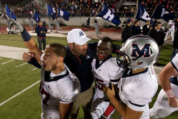 NICK de la TORRE: Chronicle THRILL OF VICTORY: Manvel coach Kirk Martin, in white cap sandwiched between Manuel Martinez (left) and Corey Seymour, relishes the District 24 4A championship and unbeaten season his team just ensured with a win over Dawson.